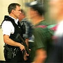 Armed police patrol Victoria Station, London