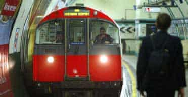 A Piccadilly line tube train arrives at Russell Square station