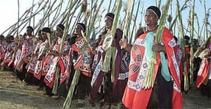 Swazi women perform a reed dance at the royal kraal in Eludzidzini