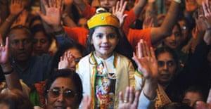 Three-year-old Komal Madh attends Janmashtami, the  festival celebrating the birthday of the Hindu deity Lord Krishna in Watford. Photograph: Fiona Hanson/PA