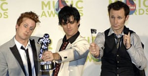 Green Day pose with one of the six trophies they won at the MTV music video awards in Miami. Photograph: Stan Honda/AFP