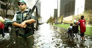 A police officer keeps watch in downtown New Orleans