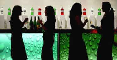 Women drink at a bar in central London. Photograph:Toby Melville /Reuters