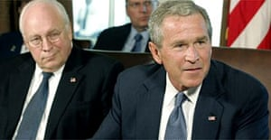 George Bush speaks to his cabinet while the vice president, Dick Cheney, listens at the White House. Photograph: Chip Somodevilla/Getty