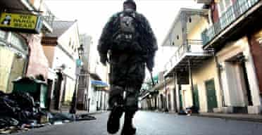 A soldier patrolling Bourbon Street in the French Quarter of New Orleans