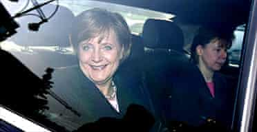 Angela Merkel arrives for a meeting with her Christian Democratic Union (CDU) party's leadership in Berlin