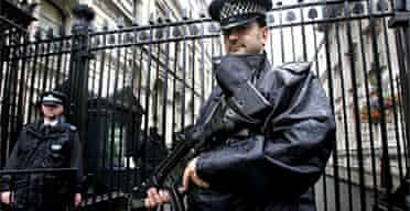Armed police officers at Downing Street. Photograph: Lindsey Parnaby/EPA