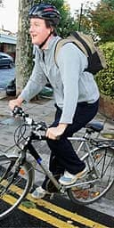 Conservative leadership contender David Cameron cycles to parliament