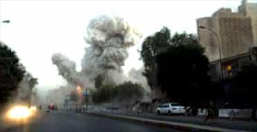 A huge explosion is seen near the Palestine hotel in Baghdad. Photograph: Khalid Mohammed/AP