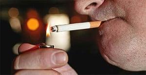 A man lights a cigarette in a pub in Nottingham