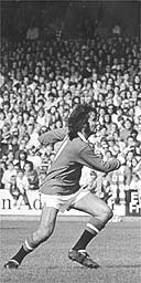 George Best in action for Manchester United in a match against Northern Ireland in September 1971