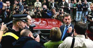 David Blunkett faces the photographers following his resignation speech