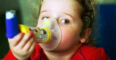 Four-year-old Georgia Conely inhaling steroids to treat her asthma. Photograph: Sean Smith/Guardian