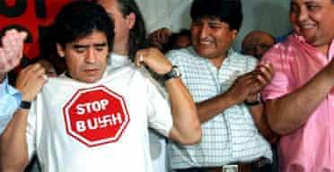 Former football star Diego Maradona shows his T-shirt with an anti-George Bush slogan. Photograph: Daniel Luna/AP