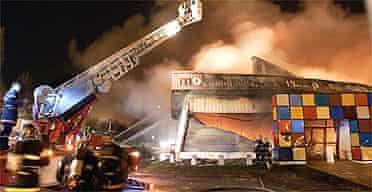Firefighters fight a blaze at a furniture warehouse in Arras, northern France