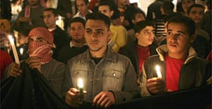 Jordanians hold candles during a vigil on the entrance steps of the SAS Radisson hotel to commemorate the suicide bombings. Photograph: Marco Di Lauro/Getty