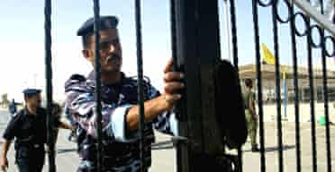 A Palestinian policeman at the gate of the Rafah border crossing with Egypt, in the southern Gaza strip. Photograph: Said Khatib/AFP/Getty Images
