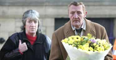 Billy Jagger, the father of murdered police officer Sharon Beshenivsky, is accompanied by her stepmother Joyce Wadsworth as he brings flowers to the scene of the shooting in Bradford city centre. Photograph: John Giles/PA