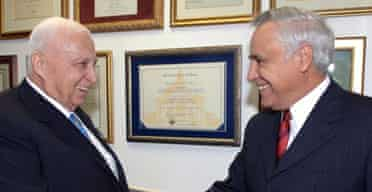 The Israeli prime minister, Ariel Sharon (l), meets the country's president, Moshe Katsav, to ask for a dissolution of parliament in preparation for early elections. Photograph: Avi Ohayon/EPA