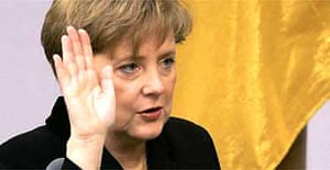 Germany's new chancellor, Angela Merkel, taking the oath of office