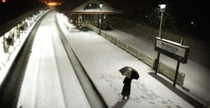A commuter waits for the first train to arrive at Aviemore station in Scotland. Photograph: Andrew Milligan/PA