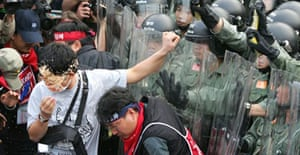 Hong Kong riot police use pepper spray to prevent South Korean anti-globalisation protesters marching on the main venue for WTO talks. Photograph: Claro Cortes IV/Reuters
