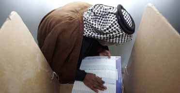 An Iraqi fills in his ballot paper at a Sadr city polling station in Baghdad during Iraq's historic parliamentary election. Photograph: Ali Jasim/Reuters