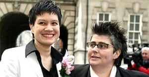 Shannon Sickles (left) and Grainne Close arrive at Belfast city hall as the first set of civil partnership ceremonies for gay couples in the UK takes place in Northern Ireland. Photograph: Paul Faith/PA