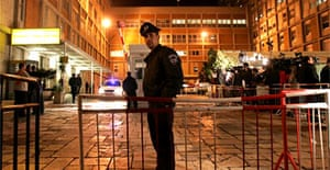 An Israeli policeman stands outside the emergency room of the Hadassah hospital in Jerusalem where Ariel Sharon was undergoing surgery after suffering a stroke. Photograph: Oded Balilty/AP