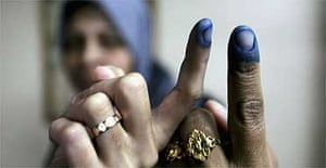 Women show their inked fingers after voting in the Palestinian elections in Gaza City