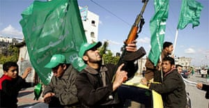 A Hamas supporter fires celebratory shots in the air in the northern Gaza Strip. Photograph: Patrick Baz/AFP/Getty