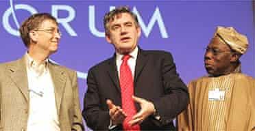 Gordon Brown (centre), Bill Gates and Nigeria's president Olusegun Obasanjo at the World Economic Forum