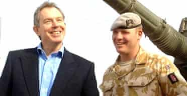 The prime minister, Tony Blair, meeting Corporal Gordon Pritchard at Basra airbase on December 22 2005. On January 31 2006 Cpl Pritchard became the 100th member of the British armed forces to die since the Iraq war began. Photograph: Stefan Rousseau/PA