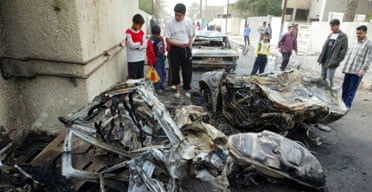 Iraqis survey the wreckage of vehicles destroyed in a car bomb attack that killed 11 people in the Doura neighbourhood of Baghdad. Photograph: Namir Noor-Eldeen/Reuters