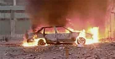 A car burns near the Italian consulate in the north-eastern city of Benghazi, Libya. Photograph: Reuters/Libya