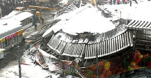 The collapsed roof of the market in Moscow