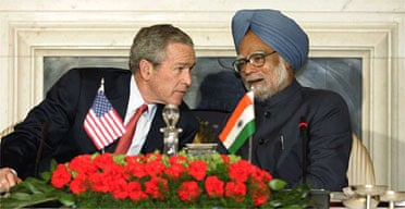 George Bush leans in to listen to the Indian prime minister, Manmohan Singh. Photograph: Charles Dharapak/AP