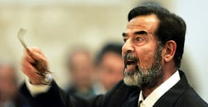 Saddam Hussein argues with the chief judge as he givess evidence for the first time during his trial in Baghdad. Photograph: Jacob Silberber/AP