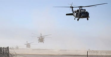 US helicopters fly from a military base in Iraq during Operation Swarmer