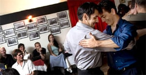 Couples dance the tango at La Marshall, the only gay milonga in Buenos Aires. Photograph: Dan Chung