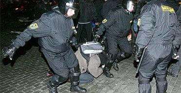 Riot police arrest an opposition supporter in Minsk, Belarus