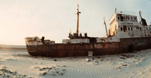 An abandoned ship sitting on the sand in the deserts left by the shrinkage of the Aral Sea. Photograph: Victor Vasenin/EPA
