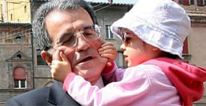Romano Prodi holds his niece Chiara leaving a polling station in Bologna
