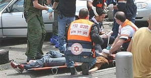 Israeli medics helps people wounded during a suicide attack in Tel Aviv