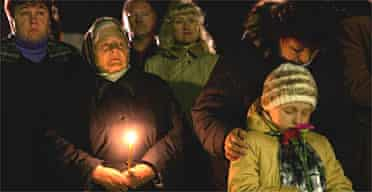 Ukrainians participate in a ceremony to commemorate those who died after the Chernobyl nuclear disaster. Photograph: Oded Balilty/AP