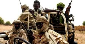 Sudan liberation army soldiers patrol the town of Muhujariya in south Darfur. Photograph: Khaled El Fiqi/EPA