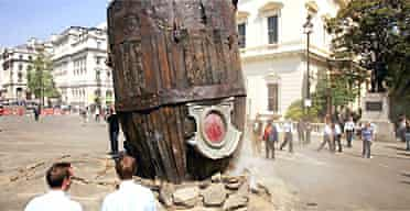 Passersby examine the 'spaceship' in Waterloo Place