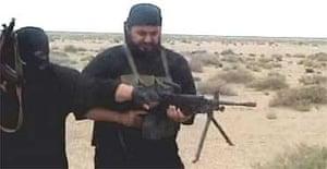 A video grab of Abu Musab al-Zarqawi getting help with a machine gun