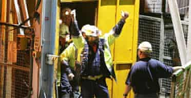 Tasmanian miners Todd Russell and Brant Webb wave as they emerge from the mine lift. Photograph: Ian Waldie/Getty