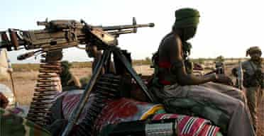 Sudan Liberation Army soldiers on patrol in North Darfur, Sudan. Photograph: Nic Bothma/EPA